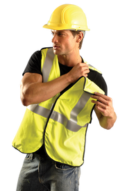 Occunomix Class 2 FR CAT 1 Breakaway Safety Vest - Occunomix Front view of man wearing Occunomix yellow solid safety vest with 2 2 inch silver reflective tape from waist to shoulders and 1 2 inch silver reflective tape around the waist. Man holding left should of vest away showing that this is a break-away vest