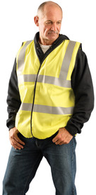 Occunomix Class 2 FR CAT 1 Solid Dual Stripe Safety Vest - Man wearing Occunomix High visibility yellow solid vest with hook & loop closure, 2 silver reflective tape placed horizontal around vest at mid section and under arms and silver reflective tape going up the front and over both shoulders