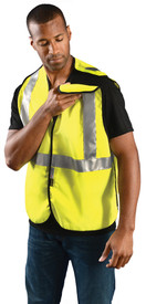 Occunomix Class 2 FR CAT 1 BreakAway Hook & Loop Safety Vest - Man wearing Occunomix High visibility yellow solid vest with hook & loop closure, breakaway left shoulder, silver reflective tape placed horizontal around vest at mid section and silver reflective tape going up the front and over both shoulders