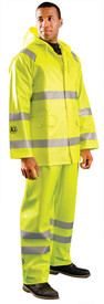 Occunomix Class 3 HRC 2 Waterproof Rain Coat - Man wearing Occunomix High visibility yellow rain jacket and rain  pants. Rain Jacket has drawstring hood, 2 large flap pockets with flaps dual silver reflective tape wrapped around both arms below the elbow, wrapped around jacket and silver reflective tape going up front of jacket and over both shoulders. Matching Rain pants has dual silver reflective tape wrapped around both legs below the knees.