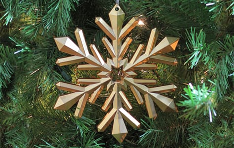 Bronze Snowflake Christmas Ornament on Christmas Tree