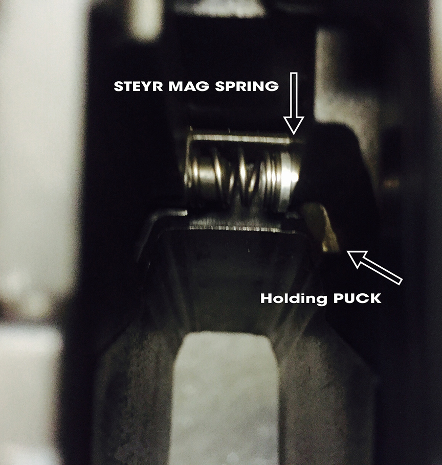 steyr-mag-spring-puck-assembly-in-pistol.jpg