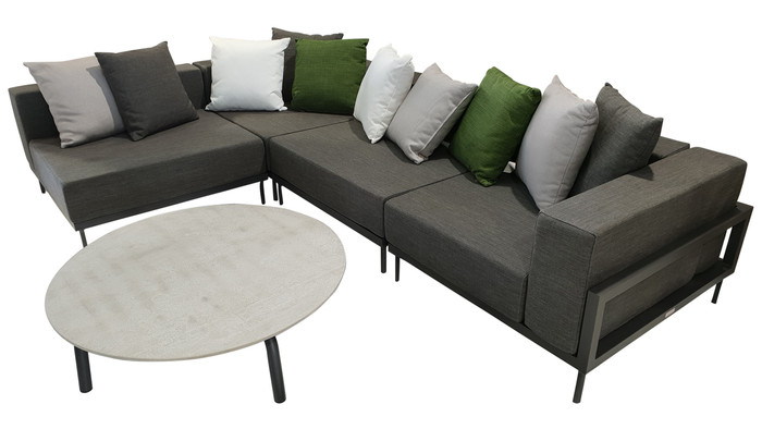 Cleo Alu modular outdoor sofa set comprising 2 x corner sofas and 2 x single sofas. Picture also shows scatter cushions available separately and a cleo concrete top coffee table