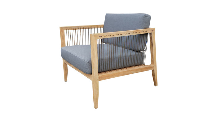 Angled view of Astoria low lounge chair in teak wood and synthetic cord