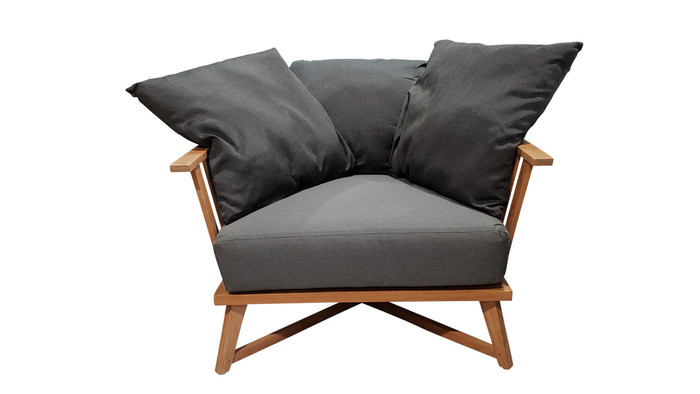 Front view of Ibiza outdoor arm chair teak frame, shown with 3 included scatter cushions