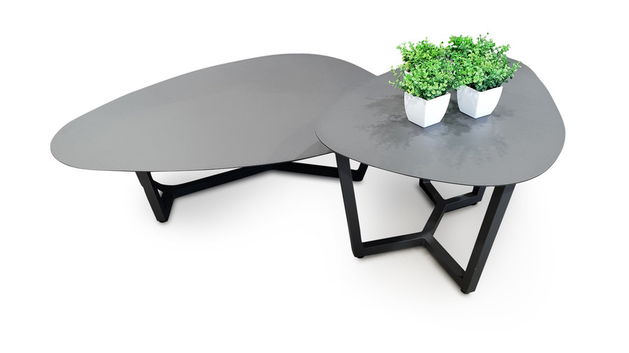 The Leaf outdoor coffee table is the smaller and taller of 2 available Leaf coffee tables. In this picture, you can see the coffee table nested up against the larger and lower Leaf coffee table.