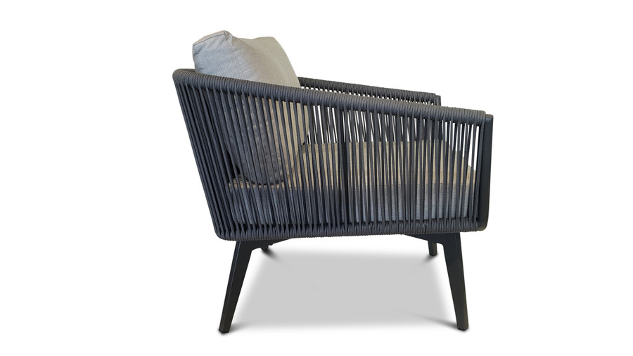 Side view of Diva outdoor lounge chair in charcoal powder-coated aluminium with outdoor rope and Sunbrella cushions.