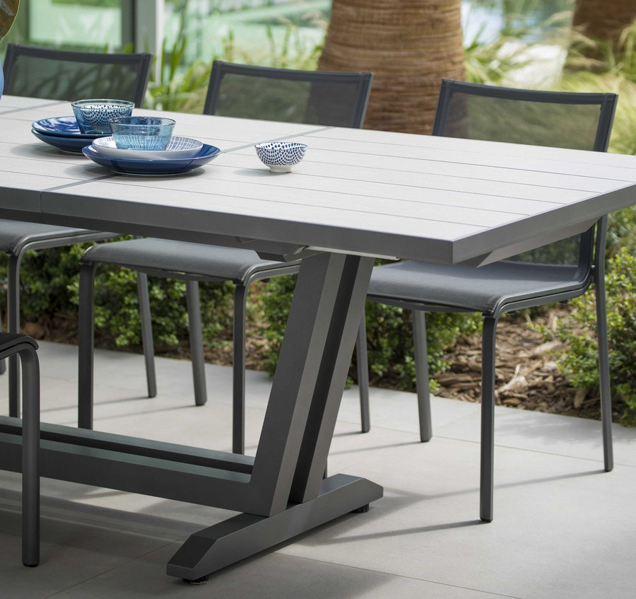 Amaka table shown in Linen Beige HPL top and Space Grey aluminium frame