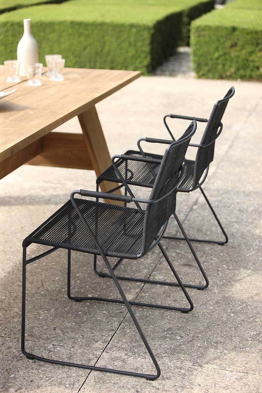 James outdoor dining arm chair in Lava Rope used with the Vista dining table
