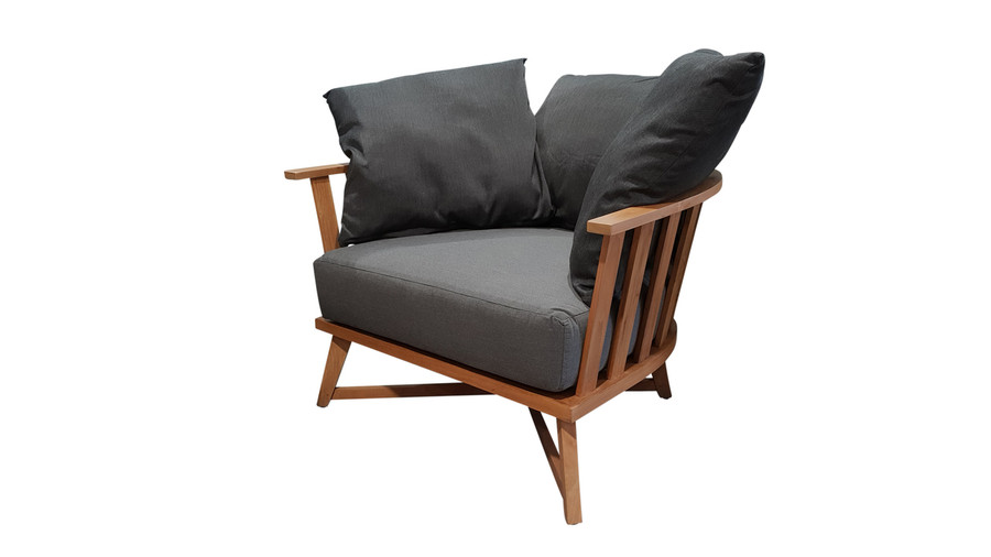 Angle view of Ibiza outdoor arm chair teak frame, shown with 3 included scatter cushions