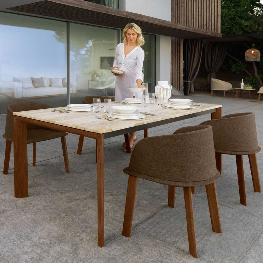 Shown with classic golden travertine top. Cleo dining chairs shown in picture not stocked. Available by special order only