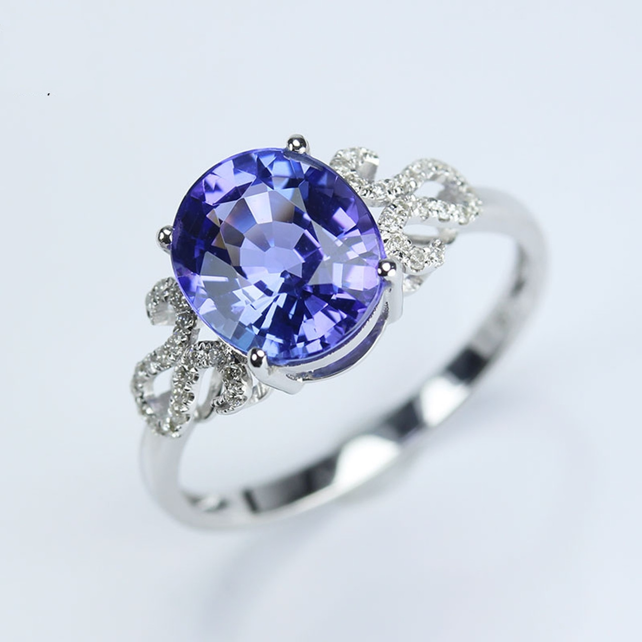 gold vanessa white and tanzanite en diamond ring with diamonds