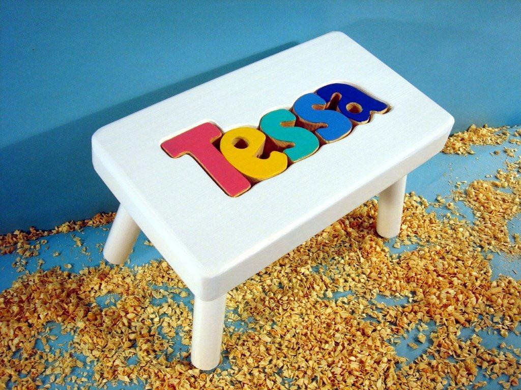 white puzzle stool with jewel letters