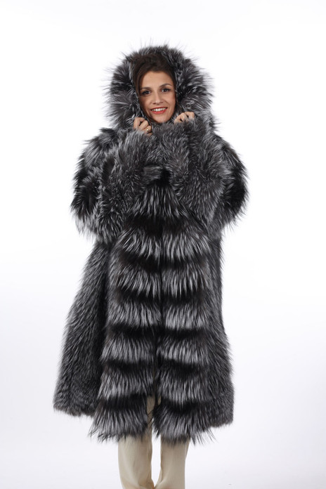 Fully let out silver fox fur coat with hood featuring an impressive waterfall hem on model