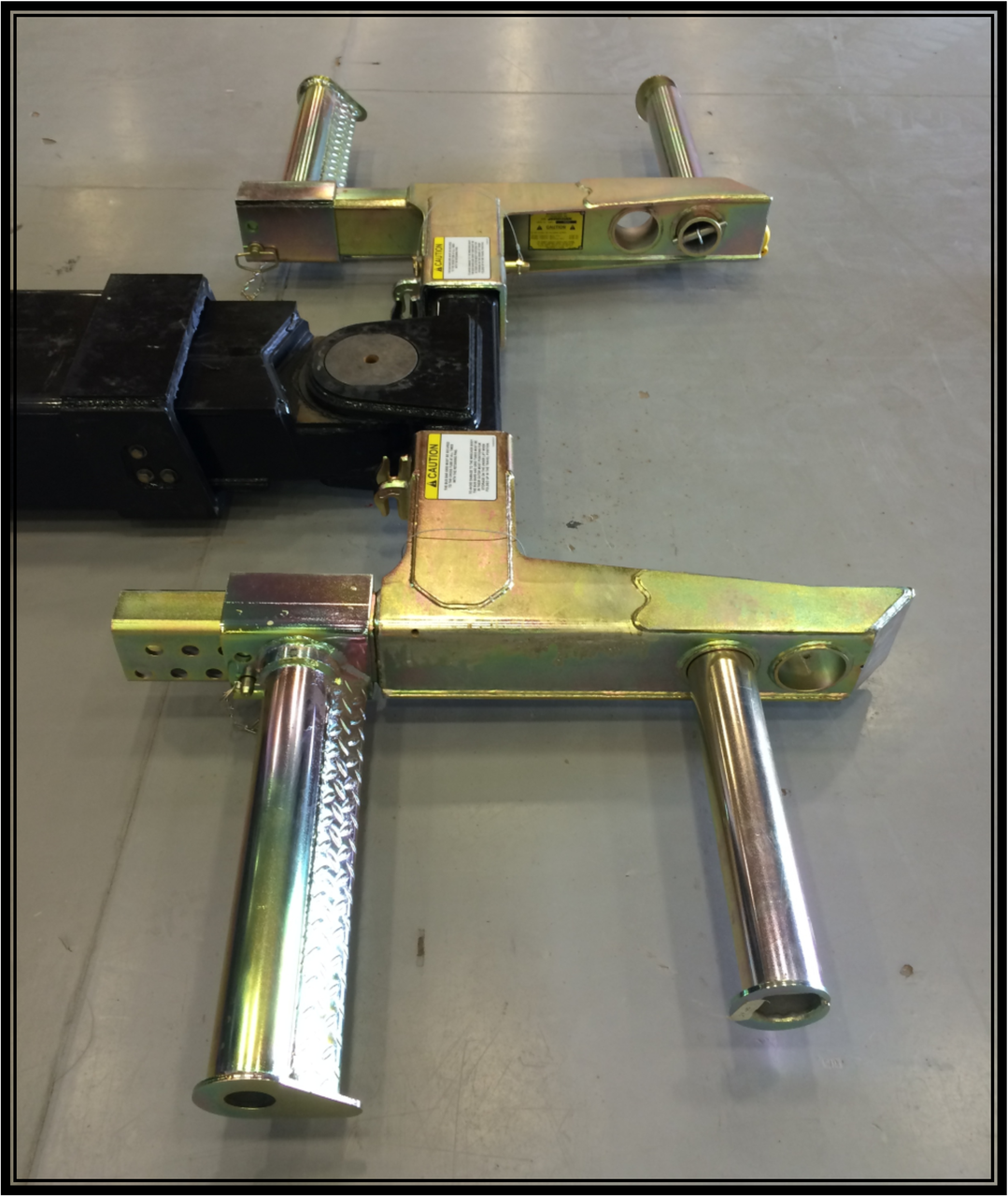 This product is a Jerr Dan Bus Arm, wheel grid, and tire lift installation