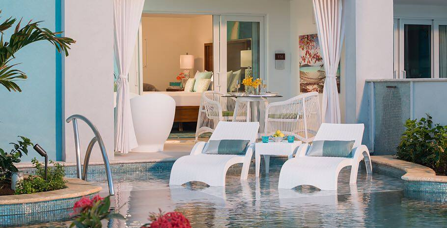 Wovenlook Chaises shown sitting in shallow pool sun shelf