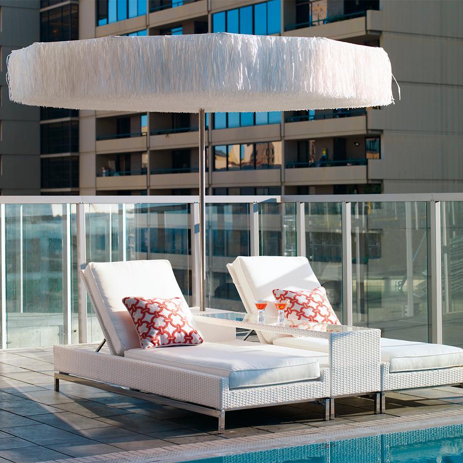 Frou Frou Umbrella on an Urban Balcony