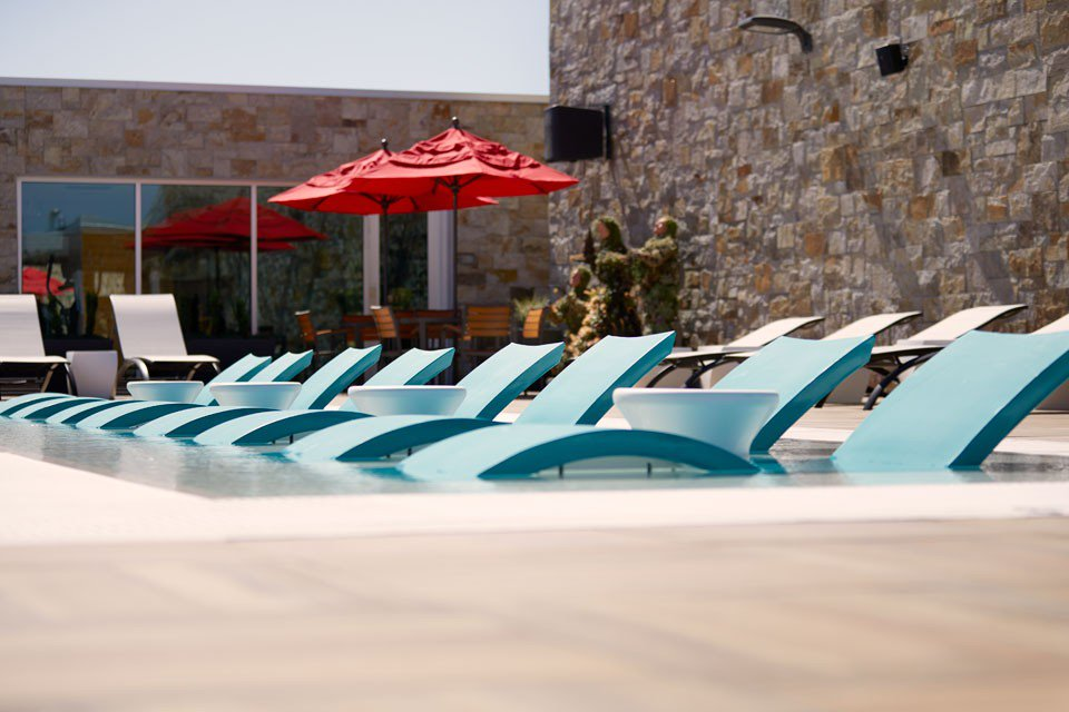 Tanning Pool with Ledge Lounger Chaises and Table