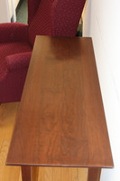From this view the long sleek lines of this table are simply stunning! An enhancement to any hallway, or common space!