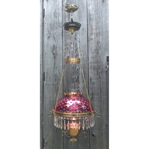 L18136 - Antique Brass Kerosene Lamp with Cranberry Glass