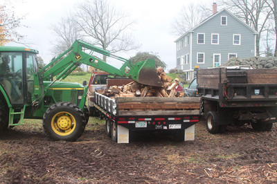 Loading  firewood for a customer