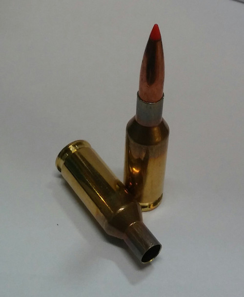 6mm BR empty brass and 1 dummy round loaded with 105 Amax