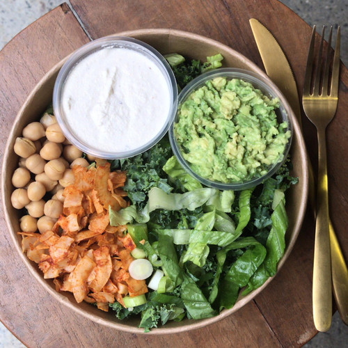 Vegan Caesar Salad, who would have thought it possible? But our version is sure to rival the original. Creamy dressing made with cashews, is combined with Kale and Cos Lettuce. And then we make smoky vegan bacon with coconut chips and chickpea croutons for an added crunch.