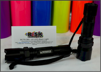 Two flashlights are shown here using intense high flux UV emitters.