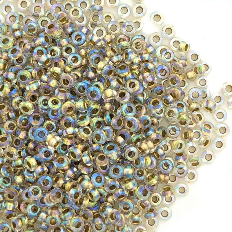 Size 11 Demi Rounds, 0262, Light Bronze-Lined Crystal Rainbow (Toho) (10 gr.)