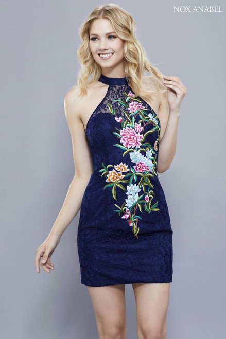 A stunning short blue lace fitted cocktail dress NX 6334 with embroidery and halter neckline that will accentuate your curves, perfect for homecoming dance or night out in the city - shop prom-avenue  Available in Navy-Floral ( as shown )