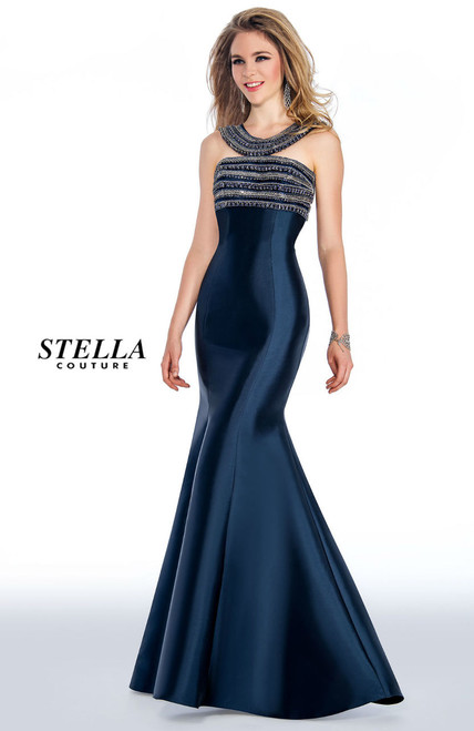 Long evening gown in mermaid style that will show off you curves for a perfect prom night with embellishments on the top of the bodice and a low open back by Stella Couture 18016- shop prom-avenue  Available in Navy