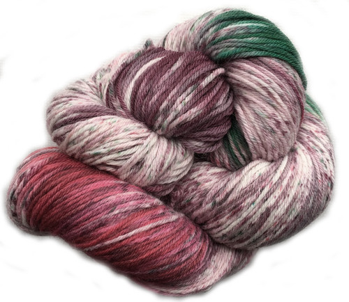 Araucania Huasco Sock Hand Paint - Galapagos Martin 1004 is a chunk of forest green, and dash of warm fuschia all wrapped up in a dusky plum and natural.
