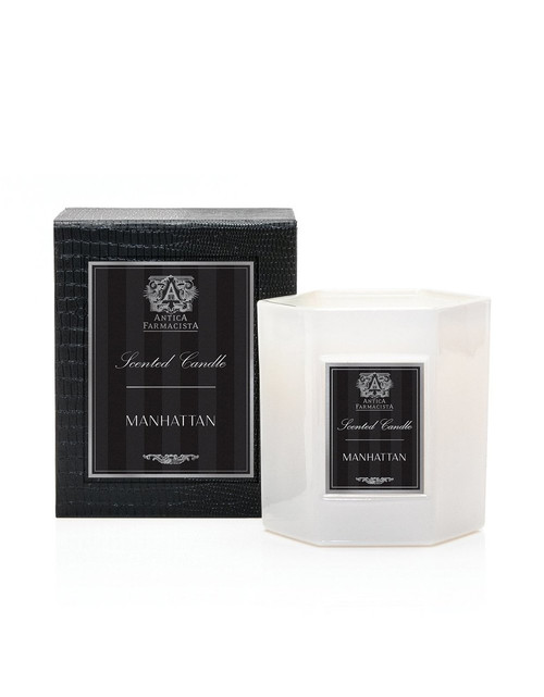 Manufacturer's Description Introducing our new Hexagonal 9oz Candle. Our signature soft white glass, filled with our soy-paraffin wax blend, results in 60 hours of beautifully scented illumination. Packaged in a luxe hinged box, embellished with a pearlescent croc texture. Each decorative box includes a set of Antica's signature matches.  Net Wt.: 9 oz.  Fragrance Notes: An ode to the classic cocktail and the city that never sleeps. Top notes of zesty Satsuma and bergamot balance the spice of aromatic black pepper. A subtle brandied cherry note is an elegant accompaniment to rich notes of deep cognac, vetiver, amber and bourbon.  Fragrance Family: soft