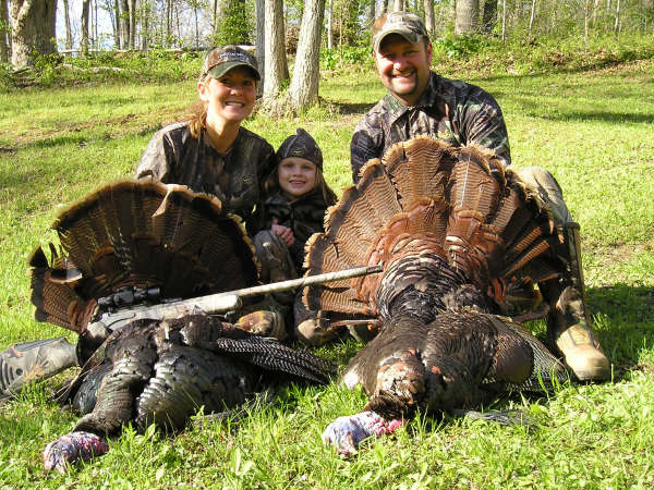 family with turkeys