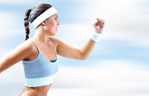 Female Jogger Wearing White Sports Headband