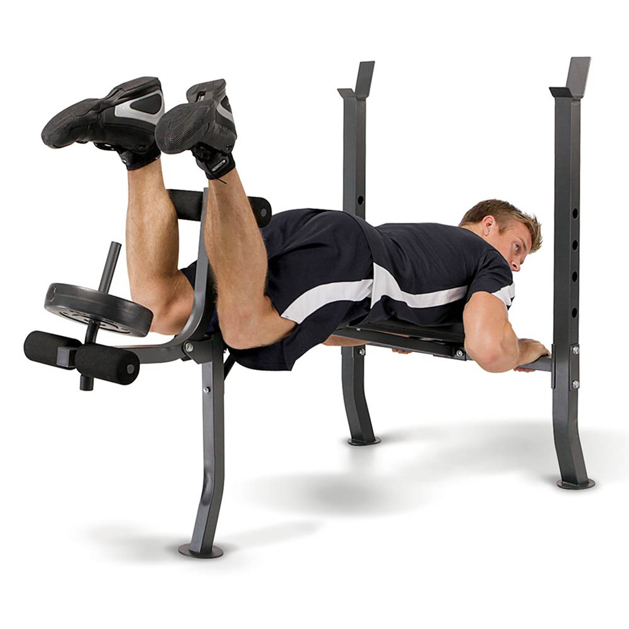 The Marcy Weight Bench 80lb Weight Set MD-2080 in use - leg curls