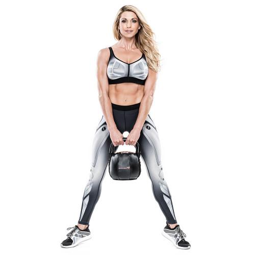 Bionic Body 25 lb. Soft Kettlebell held by Kim Lyons