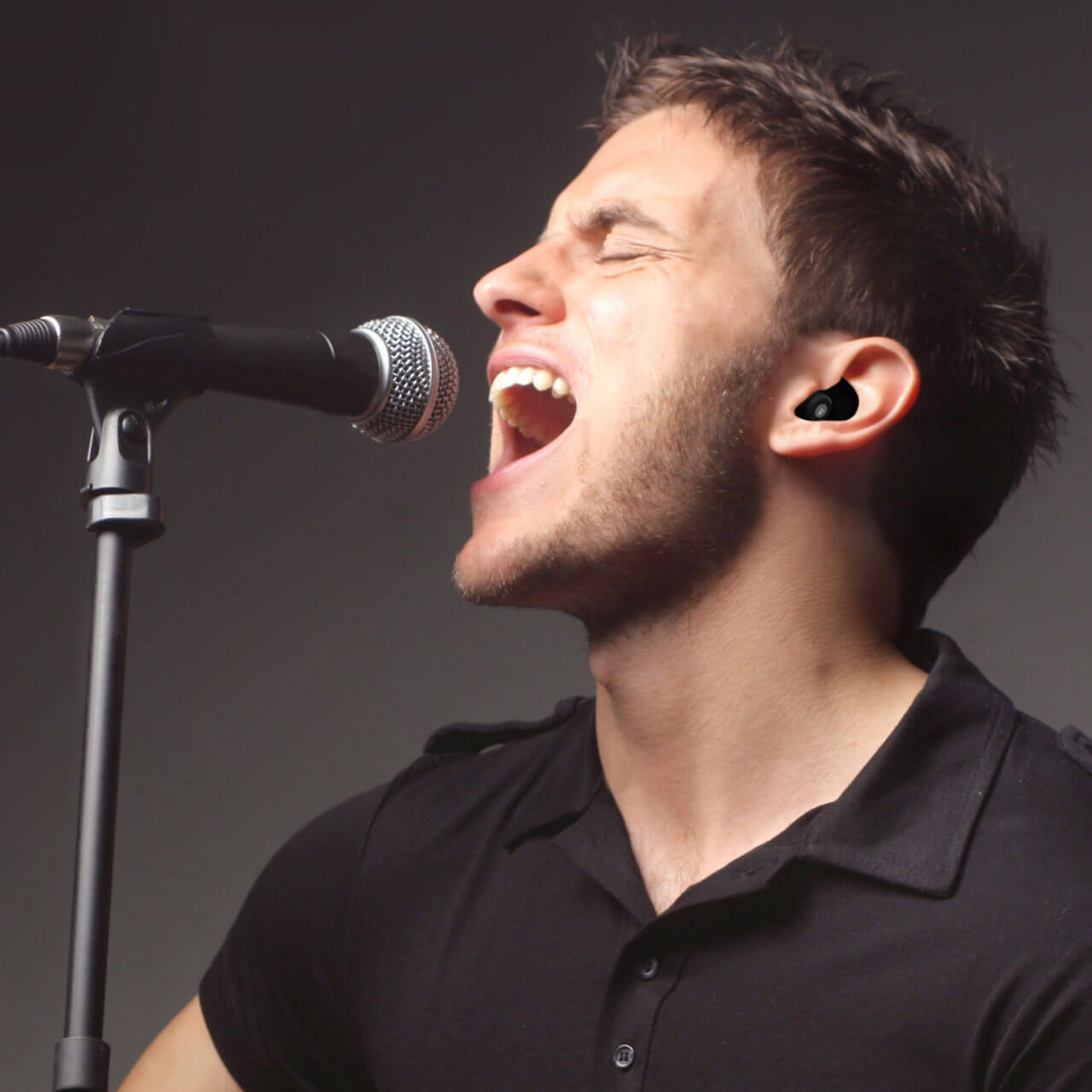 man singing while wearing black decibullz hearing protection