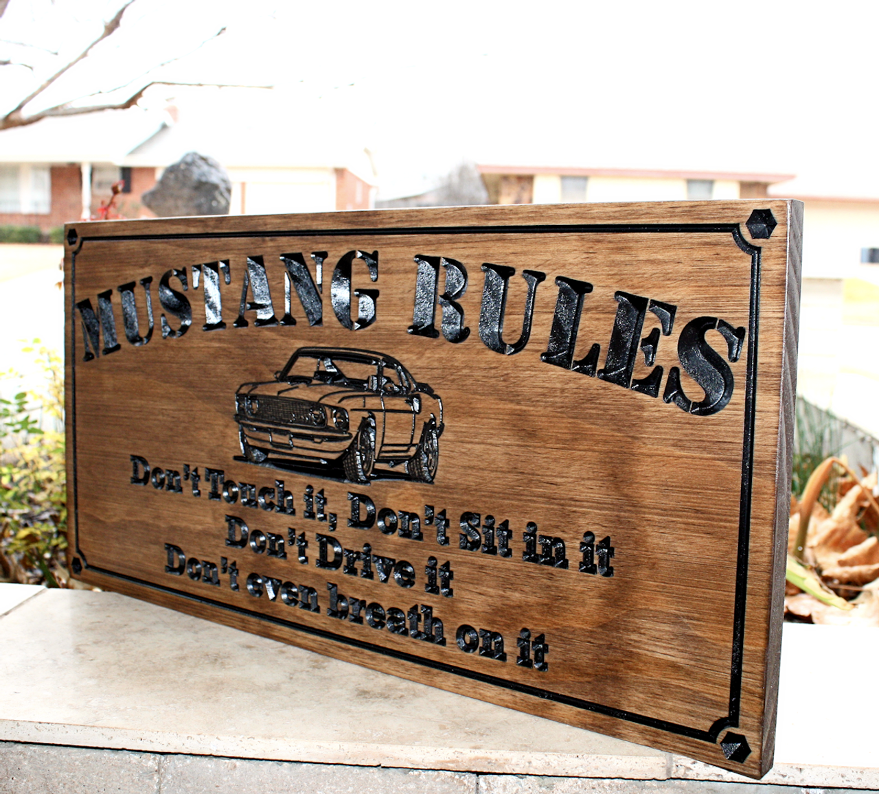 garage sign with mustang rules