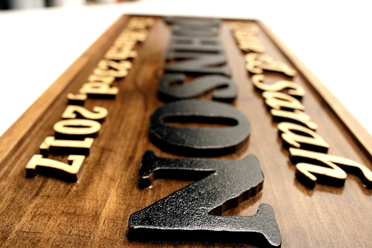 carved family wedding sign
