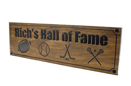 Football sign, basketball sign, crossed ice hockey sticks, crossed lacrosse sticks wooden sign