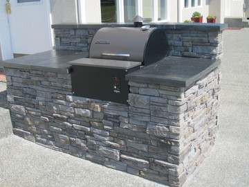 Summit Quickfit on stone barbecue.