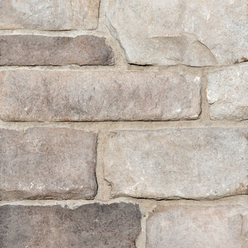 Picture of a Limestone Stone Veneer in the Dungeness color palette by Superior Stone (Lynnwood Washington based).  Dark gray grout pictured