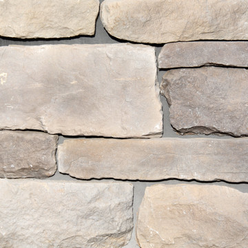 Picture of a Limestone Stone Siding in the Dungenesscolor palette by Superior Stone (Lynnwood Washington based).  Lighter grout pictured