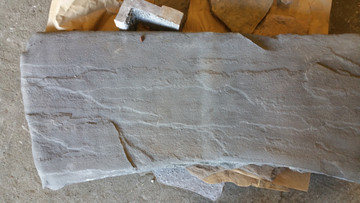top is marbled to have the look of real stone. Very nice.