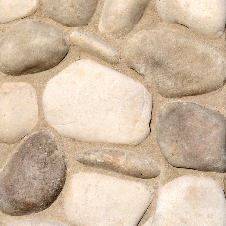 Picture of a River Rock stone siding in the Alpine color palette by Superior Stone (made in the Pacific Northwest).  Shown here with tan / sand mortar bed color.