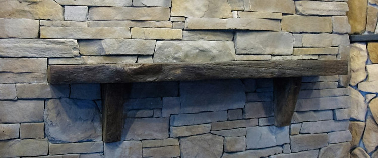 This is an assume piece that looks like a live edge wood. Yet can be installed closer to your fireplace per code. This lets you put your TV lower and helps protect it.