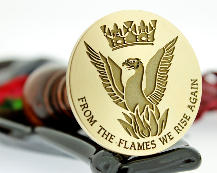 Phoenix design, with additional text (recommend 30mm plus with additional text) size shown 50mm stamp head