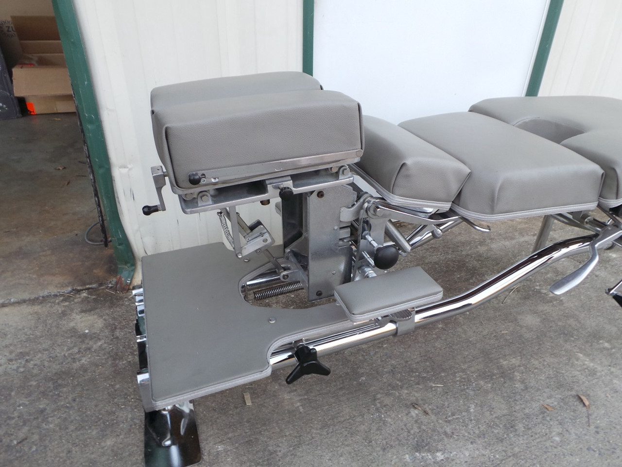 Used Zenith 55F Stationary Table Shown with Cervical Elevated