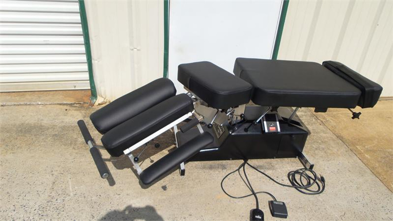 Used Leander Auto Flexion Table shown In Lateral Bending mode and Cervical tilted Down